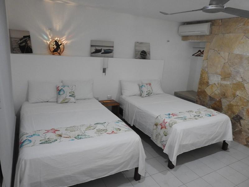 Habitaciones hotel villa de pescadores for Habitacion familiar estandar